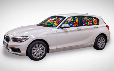 Win a brand new car. Guess how many balls are inside.